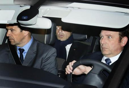 TOPSHOTS  Former French president Nicolas Sarkozy (C) leaves Bordeaux' courthouse on March 21,...